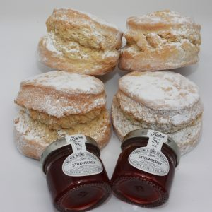 scones and strawberry jam on a white background