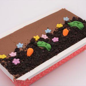 large chocolate loaf cake on white background