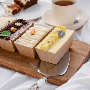 Garden party loaf cakes and cake slice on board
