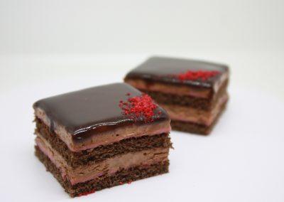 Chocolate opera cake on white background