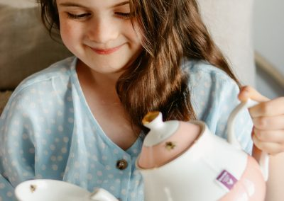 Young girl drinking a cup of yea