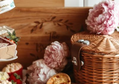 afternoon tea on cake stand with picnic basket