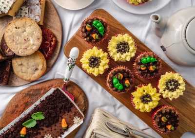 Garden party cupcakes, cookies and loaf cake on plates