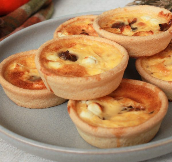autumn caramalised red onion and goats cheese mini quiches on plate