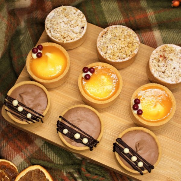 autumn sweet canapes on wood board square
