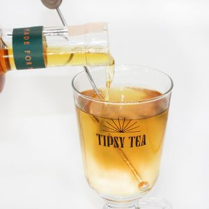 tea pourin g into branded glass with stirrer