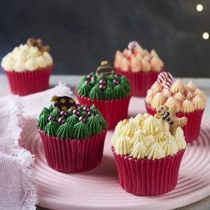 Christmas cupcakes, green, yellow and red with chocolate decorations