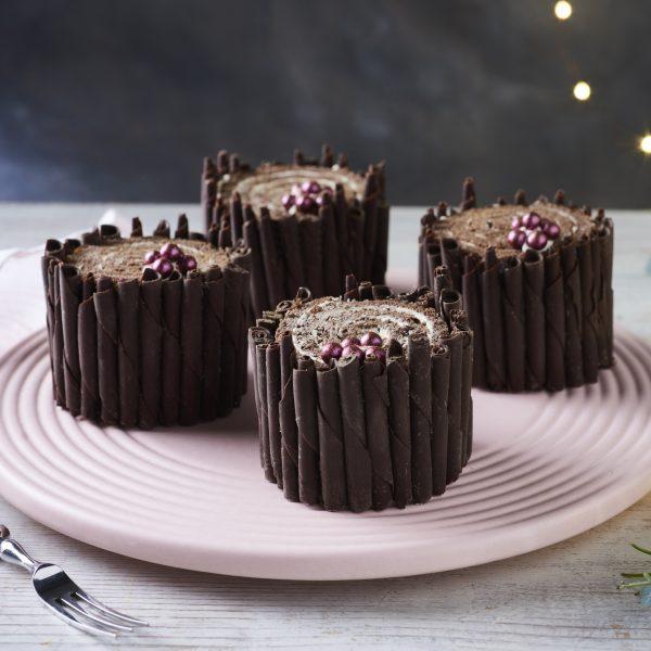 individual yule logs on pink plate