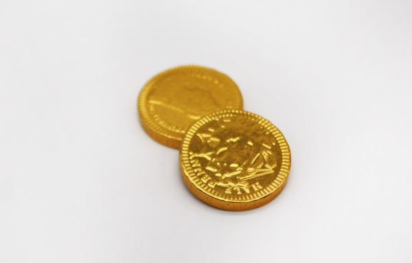 chocolate coins on white background