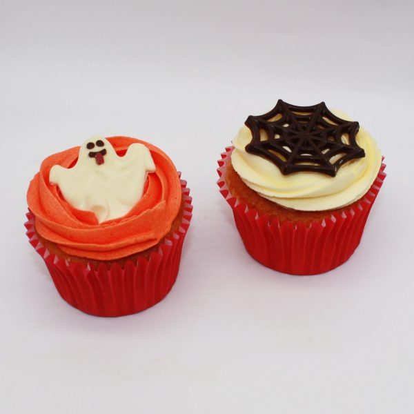 Halloween cupcakes on white background