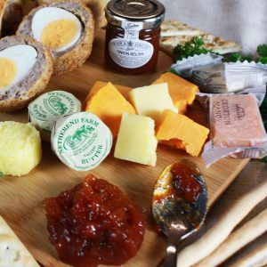 cheese with chutney and butter and spoon