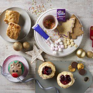 Little piglets tea with scones, sprinkles, reindeer cupcake, sausage rolls