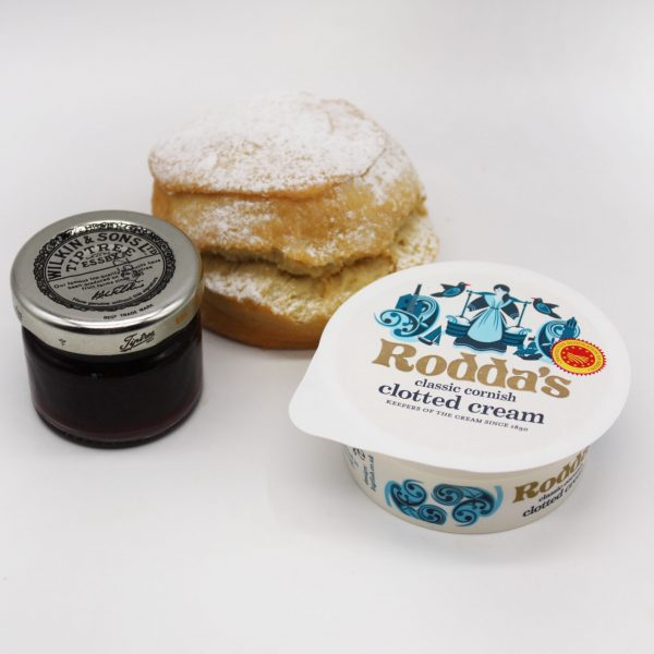 scones with cream and jam on white background