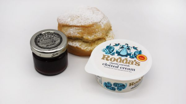 scones with cream and jam on white scones with cream and jam on white backgr