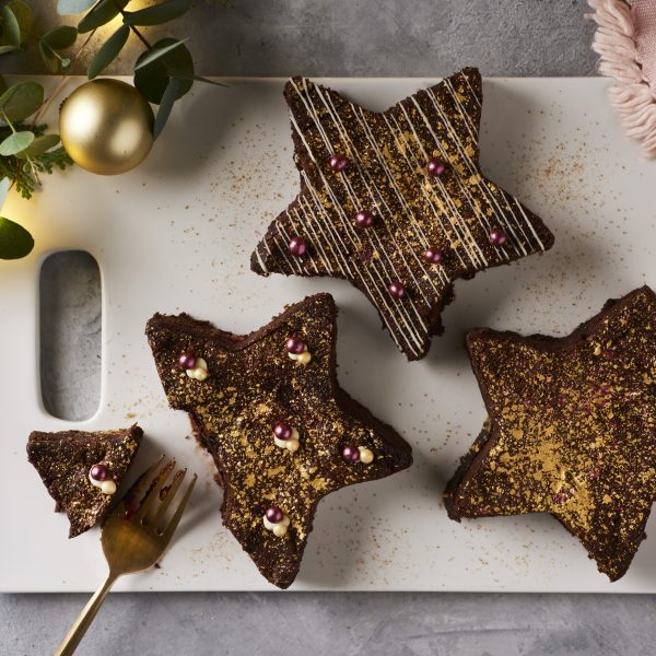 star shaped browis with fork and a bite taken out on a white board with gold baubles