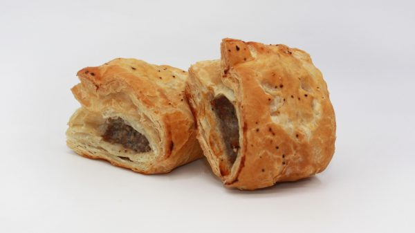 traditional saussage roll on white background